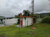 Communication facility with stilling well in background at Gamboa, Panama