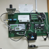 In-office base station tasked with disseminating data and alarms via a synthesized-voice telephone modem and the Internet over cellular and Ethernet, including email and text message