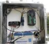 Campbell Scientific datalogger, pressure transducer, battery, solar charging system, and cellular digital modem