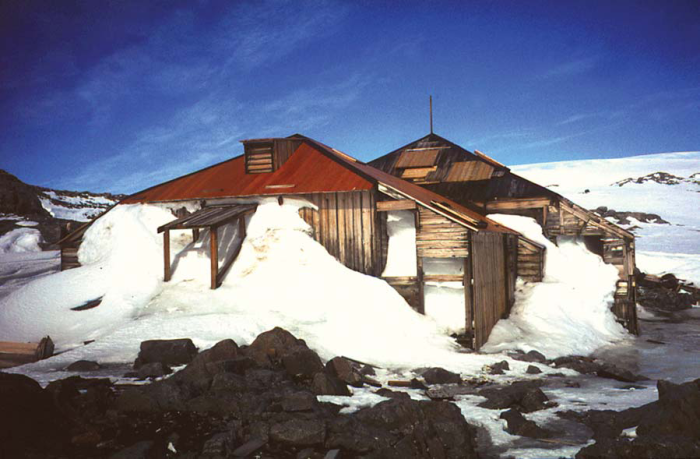 Mawson's Hut, an Australian symbol of the Heroic Era of Antarctic Exploration, sits on Cape Denison, Commonwealth Bay, a site recognized as the windiest place on earth at sea level. (Photo courtesy of Steve Martin, State Library, NSW)