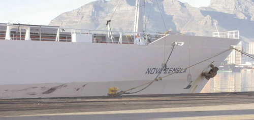 The instrumented citrus transport ship sits at the dock awaiting departure.