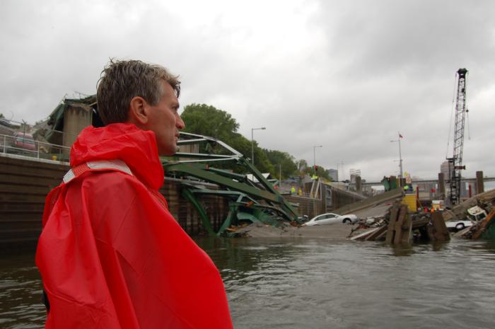 Minneapolis Mayor R. T. Rybak surveys the collapsed St. Anthony Falls Bridge. (Photo courtesy of Mike Wills)