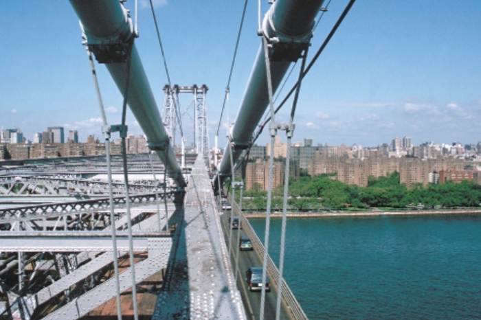 Twin suspension cables on the north side of the Williamsburg Bridge point toward Manhattan. The traffic lanes below are cantilevered and outside the suspension, attributes that made the monitoring both vital and unique. (Photo courtesy of Dave Frieder, all rights reserved)